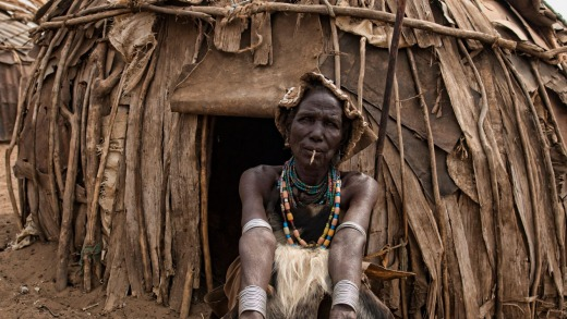 Ol Dassanech woman in front of her hut.