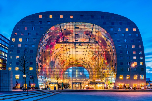 MARKET HALL, ROTTERDAM: This office and residential complex has a hollowed-out, tunnel-like interior and resembles a ...