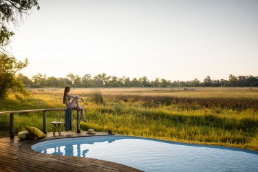 POOL ON THE EDGE OF THE SAVANNAH, BOTSWANA You've spent the morning spotting elephants and lions, then devouring a ...