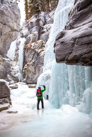 Ice climbers tackle frozen waterfalls from the canyon floor.