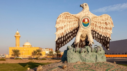 Falcon monument in a roundabout in the city of Madinat Zayed. Emirate of Abu Dhabi, United Arab Emirates.