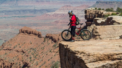 A free-rider checks out the route down from Gooseberry Mesa .