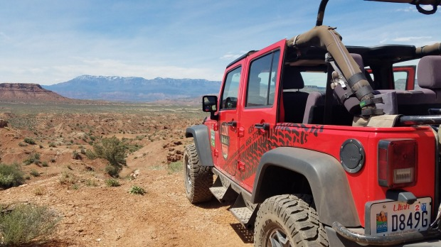 Enjoy the wind in your hair aboard a Zion Jeep Tours' open-top red jeep.