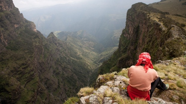 Hiker at the esarpment edge in the Simien Mountains.
