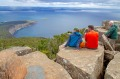 Hikers enjoy the view from the summit of Bishop and Clerk on Maria Island.