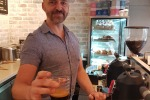 tra29-sixbestcoffee AUSTRALIA - Frankie Andrews with a Black Magic coffee Photo: Sue Williams, single use only for Traveller