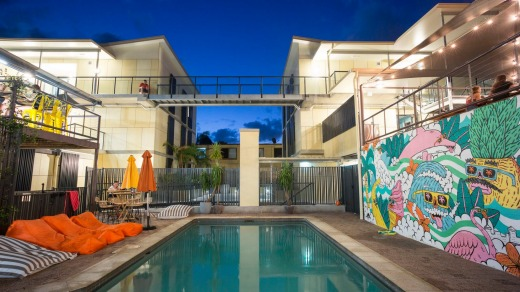 The solar-heated swimming pool with beanbag sun-loungers – and  mural   by Sydney street-artist Mulga.