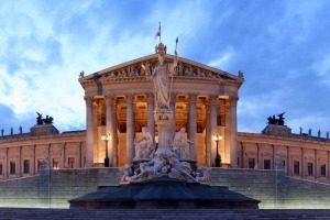 Paroramic view of the Parliament on Ringstrasse at blue hour.