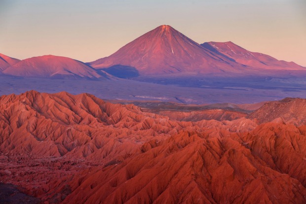 ATACAMA DESERT (CHILE) If the Amazon is defined by water, the Atacama is defined by the lack of it. Claimed as the ...