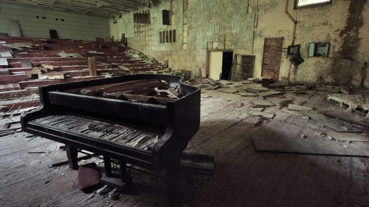 Ruined grand piano in a concert hall in Pripyat in the Chernobyl Exclusion Zone.