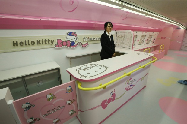 18752ee58 ... The first and second cars have white and pink bodies bearing  illustrations of Kitty. Car
