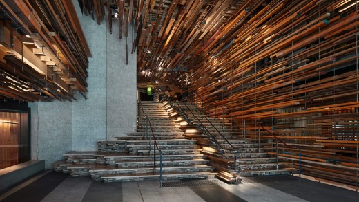 The grand staircase, composed of a frenzy of horizontal strips of recycled, rough-hewn timber.