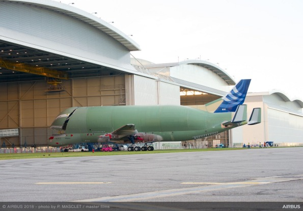 The structurally complete BelugaXL heads into a hangar at Airbus' Toulouse base in France, prior to getting its paint job.