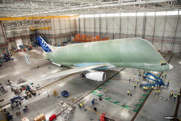 The ground test team works to determine the Airbus BelugaXL's empty-weight centre of gravity by lifting the aircraft's ...