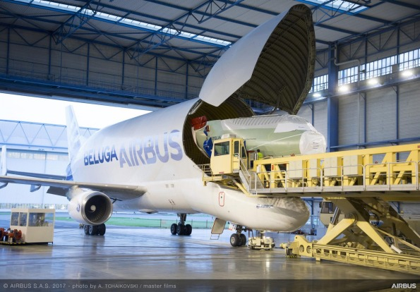 The nose section of the first BelugaXL is delivered by one of the original Beluga super transports.