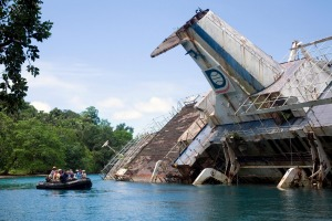 Society Expeditions' World Discoverer struck a reef off the Solomon Islands and was abandoned in Roderick Bay where it ...