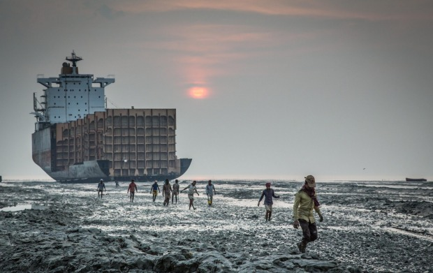 Workers leaving after a days labor at a ship braking yard in Chittagong, Bangladesh. When ships get truly dilapidated ...