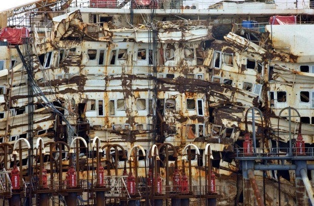 The damaged decks of the Costa Concordia as it is pulled by tug boats on its last journey before being demolished.