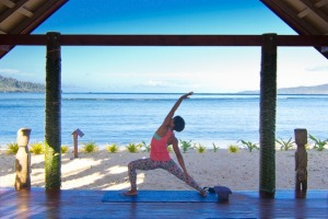 Yoga to start the day at Qamea Island Resort, Fiji.