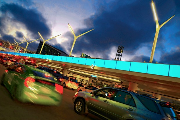 See the light show: The 91 sculptural LED light poles and a mile-long light band around LAX were finished in time for ...