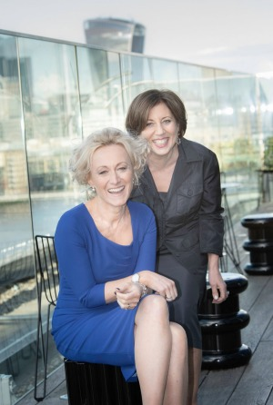 Azamara Pursuit godmothers, Lucy Huxley (left), editor-in- chief of <i>Travel Weekly UK</I>, and Ellen Asmodeo-Giglio ...