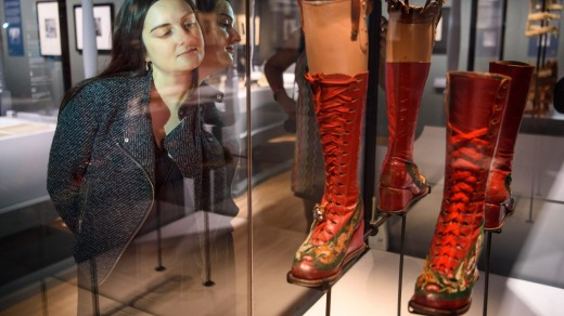 Visitors look at medical artefacts owned by Frida Kahlo, part of the Frida Kahlo: Making Her Self Up exhibition, at the ...