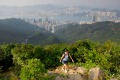 A hiker near the summit of Mount Butler on a section of the Hong Kong trail.