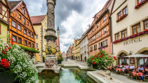 The historic town of Rothenburg ob der Tauber with fountain, Franconia, Bavaria.