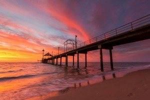 A vibrant sunset at Brighton Jetty in Brighton, Adelaide.