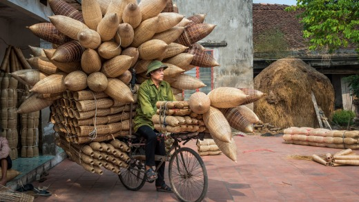 Wicker sellers cart their goods around Hanoi on bicycles.
