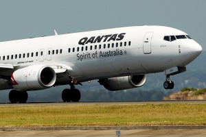 A Boeing Co. 737-800 aircraft operated by Qantas Airways Ltd. takes off from Sydney Airport in Sydney, Australia, on ...