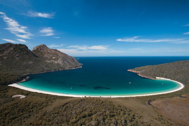 WINEGLASS BAY: Pretty much the prototype of the perfect beach, and Tasmania's most famous coastal moment, Wineglass Bay ...