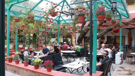 The garden cafe at Kathmandu Guest House is the perfect place to linger in the sun with a drink.