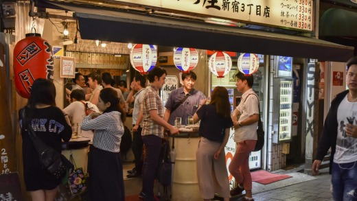 People having a drink in an izakaya, a Japanese style gastropub.