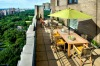 Outdoor terrace of the JW Terrace Suite at Essex House in New York, overlooking Central Park.