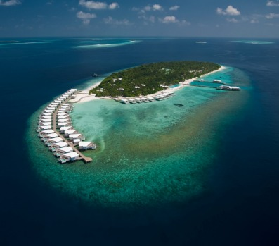 AMILLA FUSHI: Ride on sandy paths under jungle canopies to the beach, with its house reef and breath-catching drop-off, ...