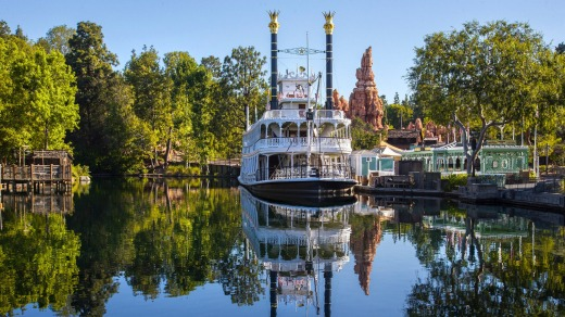 The Mark Twain Riverboat and Big Thunder Mountain in Frontierland at Disneyland Park in Anaheim, California.