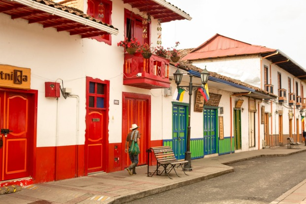 Street scene in Salento, Colombia. Colombia is the world's third-largest coffee producer and its major coffee-growing ...