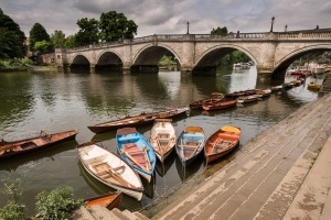 Moored rowing boats with Richmond Bridge in the background, London.