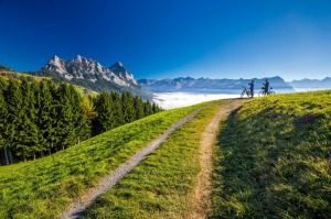 Cyclists look across towards the Mythen peaks in central Switzerland.