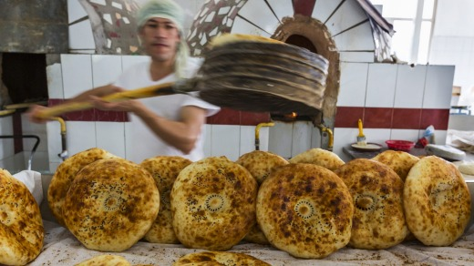 A man makes bread in the Chorsu Bazaar in Tashkent, Uzbekistan.