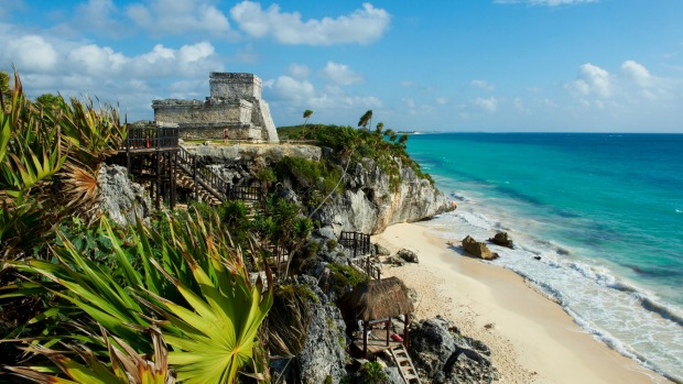 Tulum beach and El Castillo temple at the ancient Mayan site of Tulum.