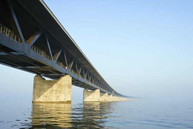 The Øresund Bridge, Malmo, Sweden: From the artificial island, it drops down and becomes the Drogden Tunnel, stretching ...