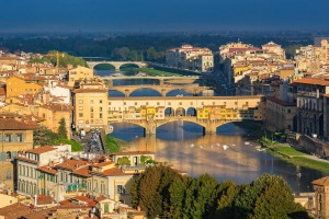 Florence, with its medieval Ponte Vecchio stone arched bridge over the Arno River.