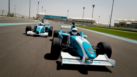 A car race in progress during the Formula Yas 3000 Driving Experience.