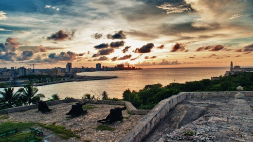 The Havana skyline and bay entrance taken from el Morro Fortress at dusk.
