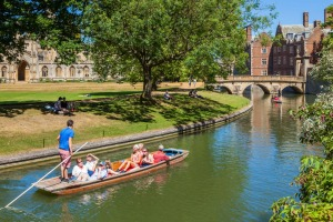 Tourists punting on the river Cam, Cambridge.