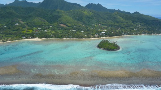 Aerial landscape view of the beautiful Muri Lagoon and a Motu Islet in Rarotonga Island in the Cook Islands.