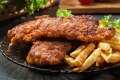 Fried fish in crispy batter with chips.