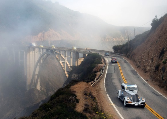 Classic cars cross over the historic Bixby Bridge  Dream Drive celebrates the reopening of Highway 1, California?s most ...